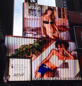 Picture of a sign in Times Square showing women wearing bras