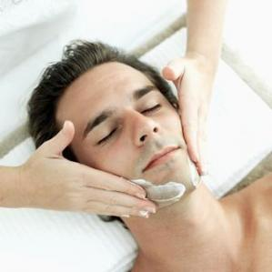 A man enjoying a facial