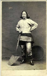 An early photo of a Wigan Pit Brow girl who wore trousers under their skirts to work the coal mines